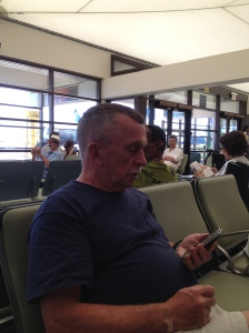 Tom texting at the airport